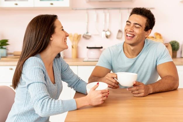 Medium shot happy couple communicating Free Photo