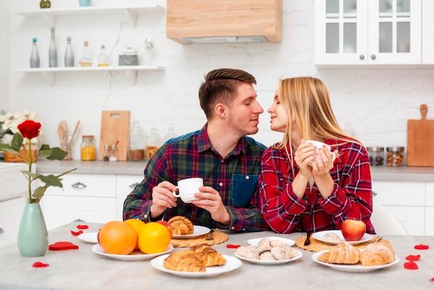 Medium shot happy couple having breakfast Free Photo