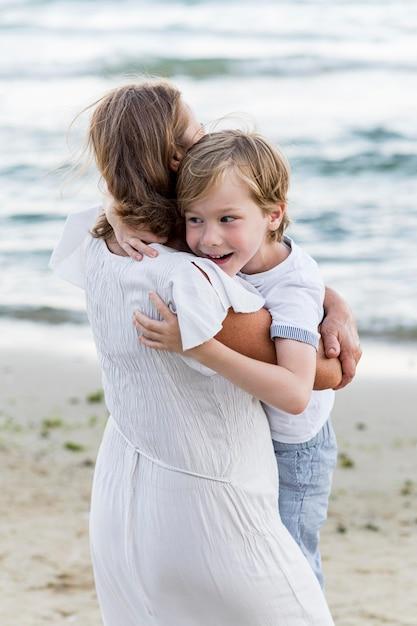 Medium shot kid hugging grandma Free Photo