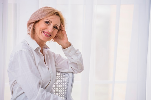 Medium shot lady with short hair looking at camera with copy space Free Photo
