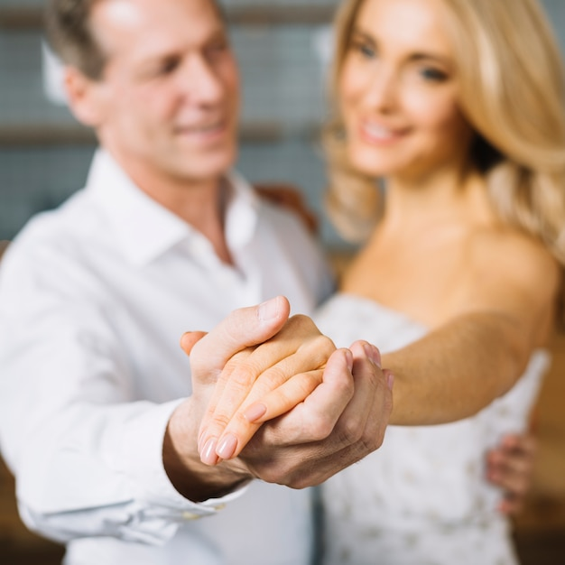 Medium shot of lovers dancing together Free Photo