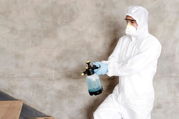 Medium shot man disinfecting stairs Free Photo