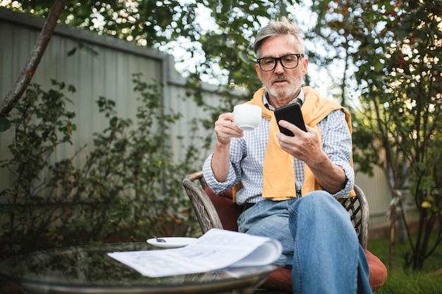 Medium shot man drinking coffee outdoors Free Photo