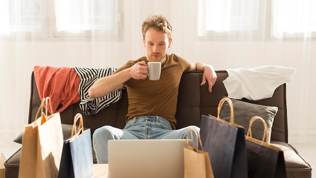 Medium shot man holding mug Free Photo