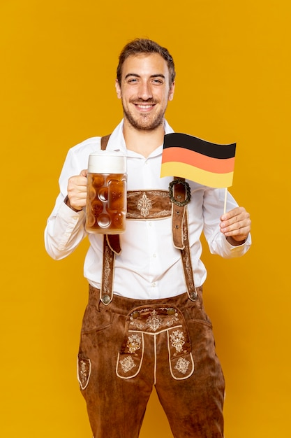 Medium shot of man with beer pint Free Photo