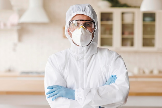 Medium shot man with hazmat suit Premium Photo