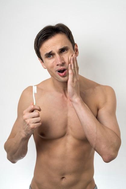 歯痛を持つミディアムショット男 無料写真