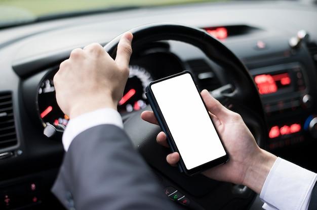 Medium shot of phone in car mock-up Free Photo