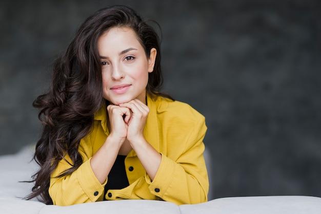 Medium shot pretty woman posing Premium Photo