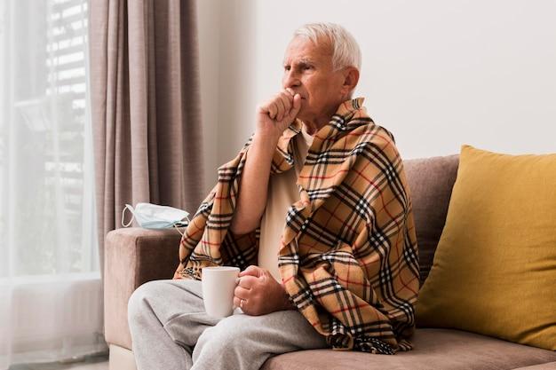 Medium shot sick man coughing Premium Photo