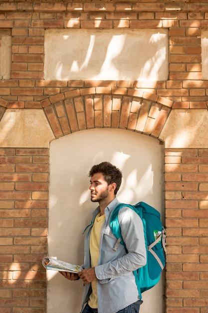 Medium shot sideways traveler looking away Free Photo