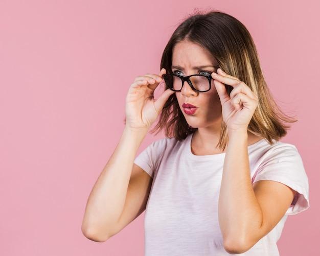 Medium shot surprised girl with glasses Free Photo