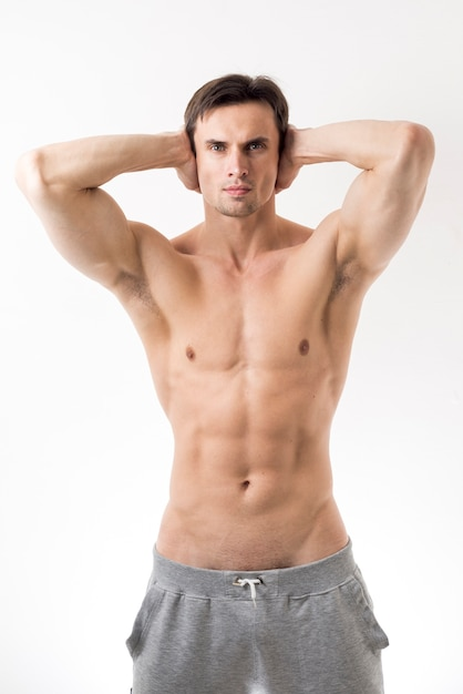 Medium shot topless man posing Free Photo