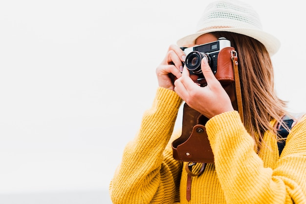 Medium shot of traveler taking a photograph Premium Photo