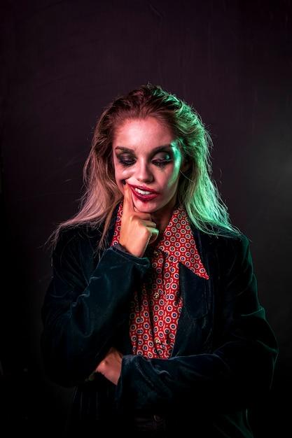 Medium shot of woman dressed as a clown Free Photo