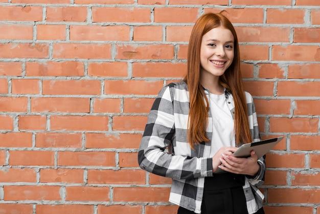 Medium shot of woman holding tablet Free Photo
