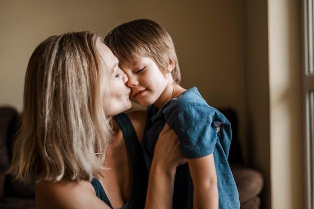 Boy woman kiss Older woman