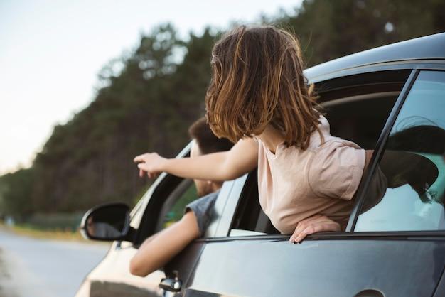 Medium shot woman pointing at road Free Photo