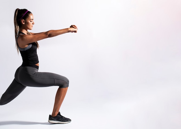 Medium shot woman stretching with copy-space Free Photo