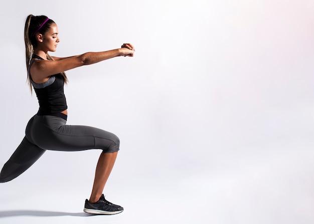 Medium shot woman stretching with copy-space Premium Photo