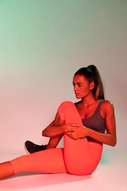 Medium shot of woman stretching Free Photo