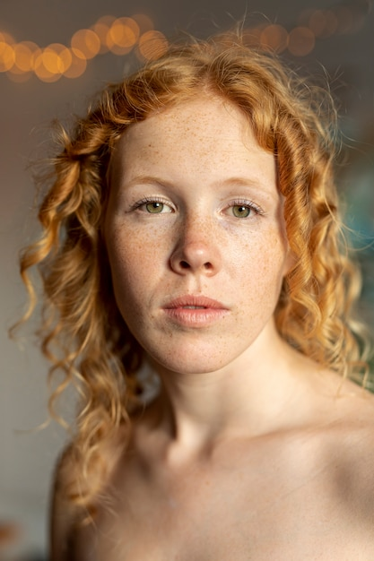 Medium shot woman with freckles posing Free Photo