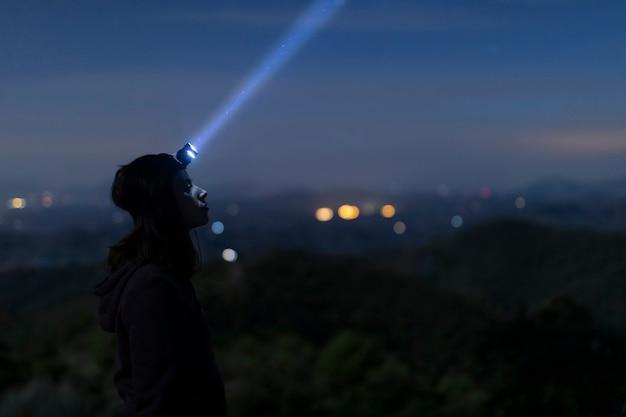 Medium shot woman with head light Free Photo