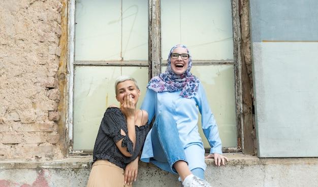 Medium shot of women laughing Free Photo
