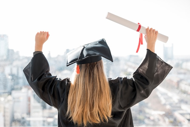 Medium shot young woman being proud at her graduation Premium Photo