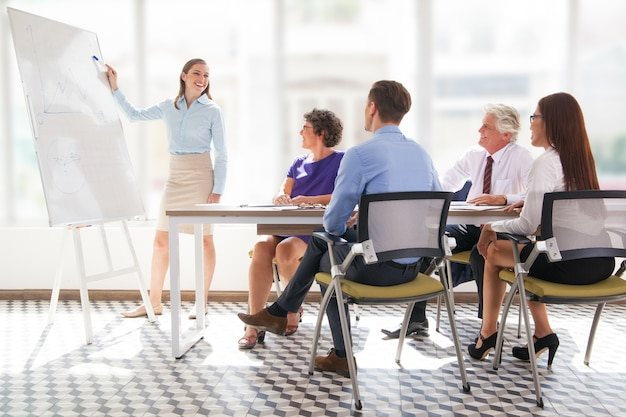 meeting mature office showing presenter Free Photo