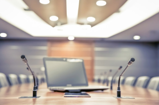 Meeting microphone and laptop in boardroom. Premium Photo