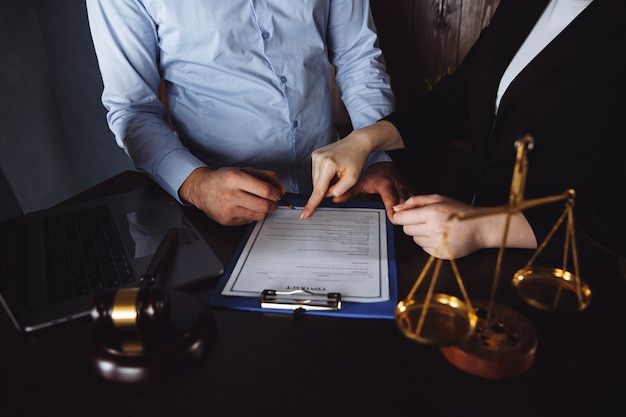 Meeting in an office, lawyers or attorneys discussing a document or contract agreement. Premium Photo