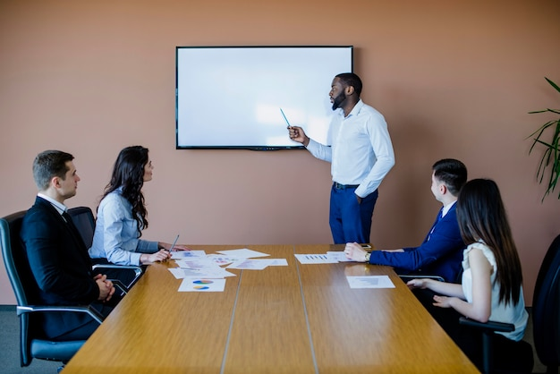 Meeting with white chalkboard Free Photo
