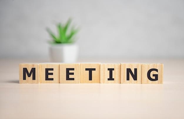 Meeting word written on wood block Premium Photo