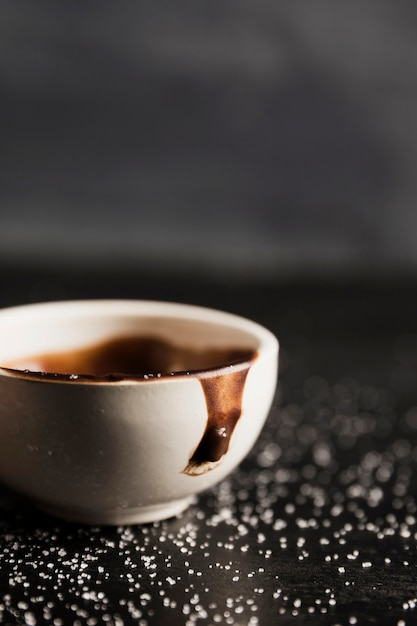 Melted chocolate in cup and sugar close-up Free Photo