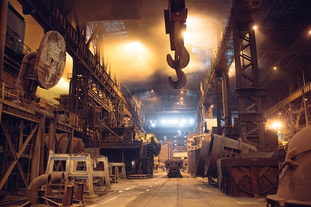 Melting of metal in a steel plant. high temperature in the melting furnace. Premium Photo