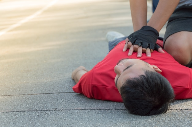 Men are doing cpr for a friend who has a heart attack Premium Photo