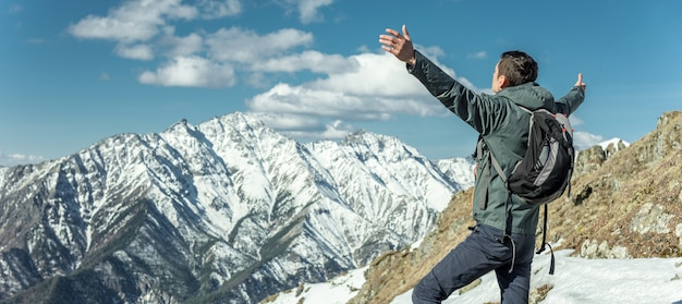 Men celebrate success by spreading their arms in snowy mountains. achievement of their goals Premium Photo