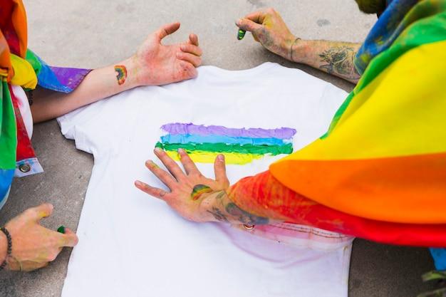 Men drawing rainbow on t-shirt Free Photo