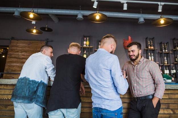 Men enjoying the evening drinks in the restaurant Free Photo