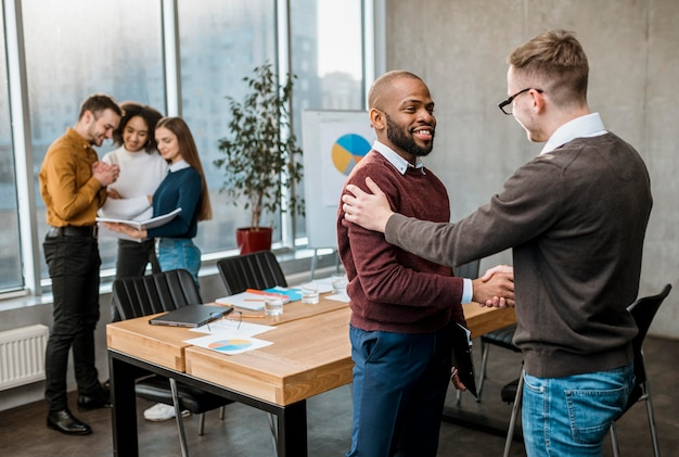 Men handshaking in agreement after a meeting Free Photo