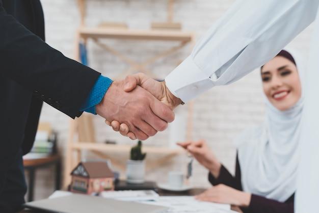 Men handshaking arab people business partnership. Premium Photo