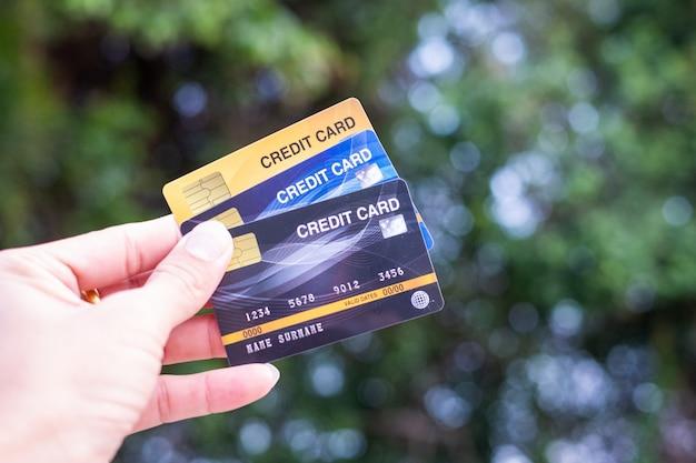 Men  hold credit card on bokeh nature Premium Photo
