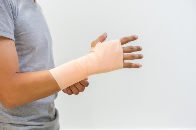 Men injured by tendon inflammation by using elastic bandage. to help reduce injuries and reduce swelling. medical and healthcare concept Premium Photo
