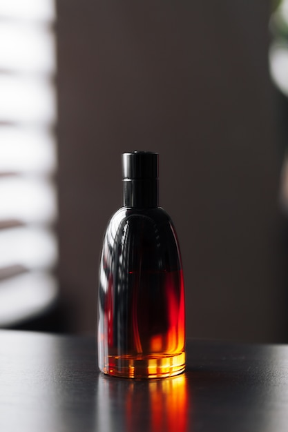 Men perfume in a glass bottle Premium Photo