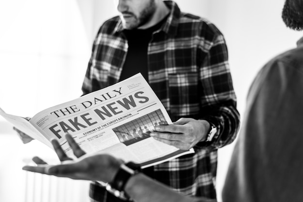 Men reading newspaper isolated on white background Free Photo