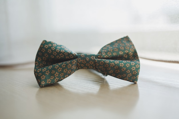 Men's bow tie on a wooden background Premium Photo