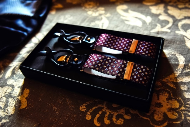 Men's clothing accessories,  new suspenders in their box. Premium Photo