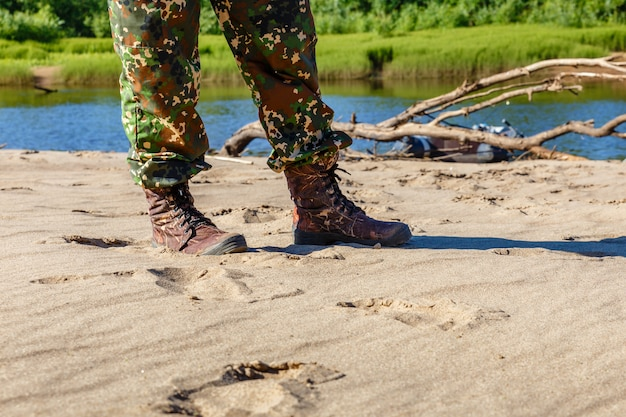 Men's feet in boots by the river Premium Photo