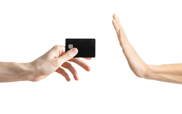 Men's hand wan't take a black credit card isolated on white Premium Photo